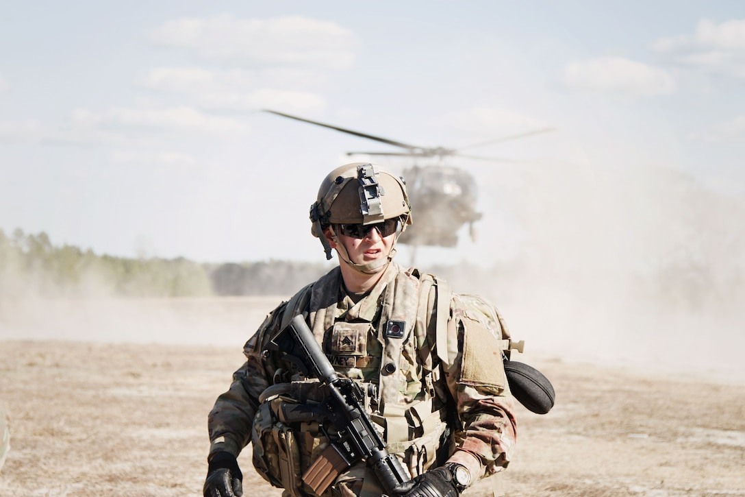 Sgt. Zachary Downey, a combat advisor team medic assigned to 2nd Battalion, 1st Security Force Assistance Brigade and Columbus, Ohio native, prepares to evacuate a simulated casualty during the unit's rotation at the Joint Readiness Training Center at Fort Polk, La., Jan. 15, 2018. The JRTC rotation was conducted in order to prepare the newly formed 1st SFAB for an upcoming deployment to Afghanistan in the spring of 2018. SFABs provide combat advising capability while enabling brigade combat teams to prepare for decisive action, improving readiness of the Army and its partners. (U.S. Army photo by Staff Sgt. Sierra A. Melendez, 50th Public Affairs Detachment, 3rd Infantry Division Public Affairs)