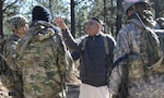 Afghan National Defense Security Forces role players talk to Capt. Justin Alexander, a combat team advisor team leader assigned to the 1st Security Force Assistance Brigade during a simulated event at the Joint Readiness Training Center at Fort Polk, La., Jan. 13, 2018. The JRTC rotation was conducted in order to prepare the newly formed 1st SFAB for an upcoming deployment to Afghanistan in spring of 2018. SFAB's provide combat advising capability while enabling brigade combat teams to prepare for decisive action, improving readiness of the Army and its partners. (U.S. Army photo by Pfc. Zoe Garbarino/Released)