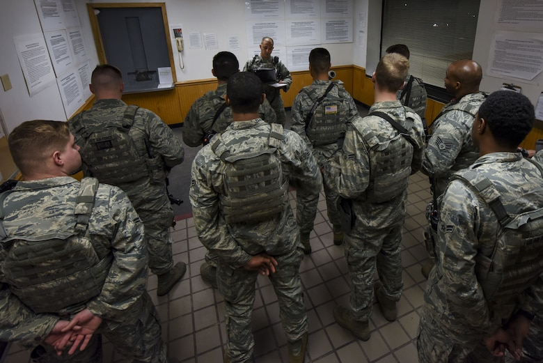 Members of the 4th Security Forces Squadron conduct an intelligence brief prior to setting out for their positions during exercise Thunderdome 18-01, Jan. 11, 2018, at Seymour Johnson Air Force Base, North Carolina. The exercise tested the squadron's ability to defend the base from a myriad of simulated attacks and react to different scenarios that they could come across in a deployed environment. (U.S. Air Force photo by Staff Sgt. Brittain Crolley)