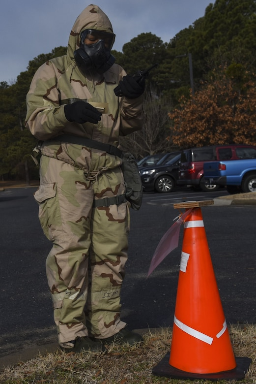 Staff Sgt. Mary McKnight, 916th Civil Engineer Squadron emergency management technician, inspects and reports the findings of a chemical agent detection paper station during exercise Thunderdome 18-01, Jan. 11, 2018, at Seymour Johnson Air Force Base, North Carolina. As a member of the post-attack reconnaissance team, McKnight checked several stations after a simulated attack to see if the areas were contaminated. (U.S. Air Force photo by Staff Sgt. Brittain Crolley)