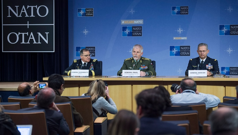 Czech Gen. Petr Pavel, center, the chairman of NATO's Military Committee, responds to a question during a news conference at NATO headquarters in Brussels after a meeting of the alliance's Military Committee.