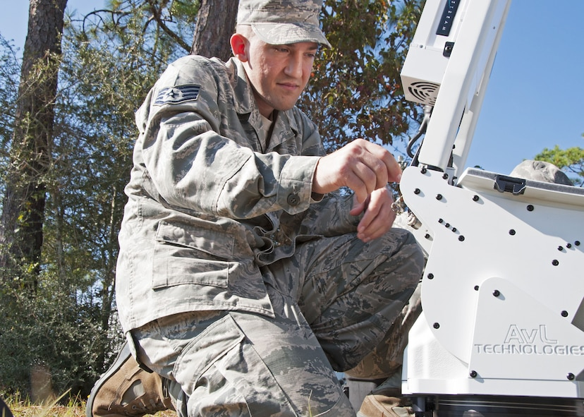 Staff Sgt. Frank Poli, a 919th Special Operations Communications Squadron cyber transmissions technician, assembles a satellite communications