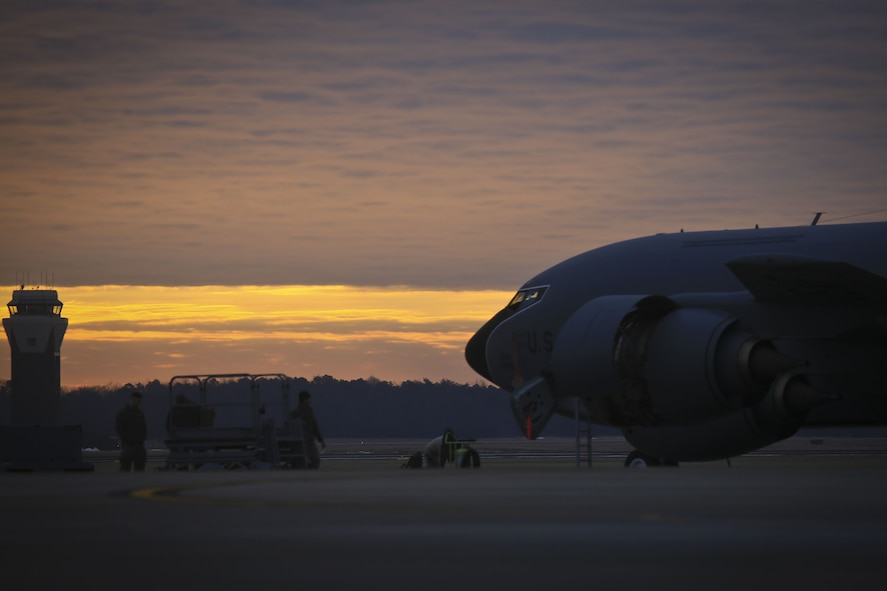 A New Jersey Air National Guard KC-135R from the 108th Wing is worked on by maintenance airmen at sunrise on Joint Base McGuire-Dix-Lakehurst, N.J., Jan. 11, 2018. (U.S. Air National Guard photo by Master Sgt. Matt Hecht)