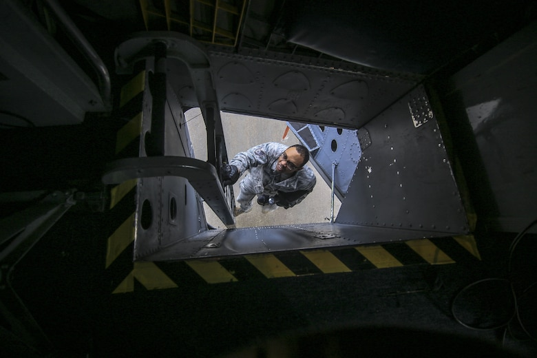 New Jersey Air National Guard Staff Sgt. Garion Reddick decends down the ladder of a KC-135R Stratoanker after doing electrical work on the aircraft on Joint Base McGuire-Dix-Lakehurst, N.J., Jan. 11, 2018. (U.S. Air National Guard photo by Master Sgt. Matt Hecht)