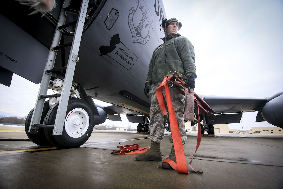 New Jersey Air National Guard Staff Sgt. Robert Cento pulls red tags during pre-flight checks on a 108th Wing KC-135R Stratotanker prior to a training flight on Joint Base McGuire-Dix-Lakehurst, N.J., Jan. 11, 2018. (U.S. Air National Guard photo by Master Sgt. Matt Hecht)