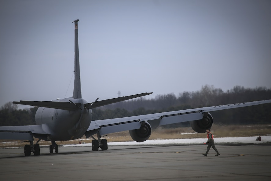 A New Jersey Air National Guard crew chief walks back to his gear after launching a 108th Wing KC-135R Stratotanker for a training flight on Joint Base McGuire-Dix-Lakehurst, N.J., Jan. 11, 2018. (U.S. Air National Guard photo by Master Sgt. Matt Hecht)