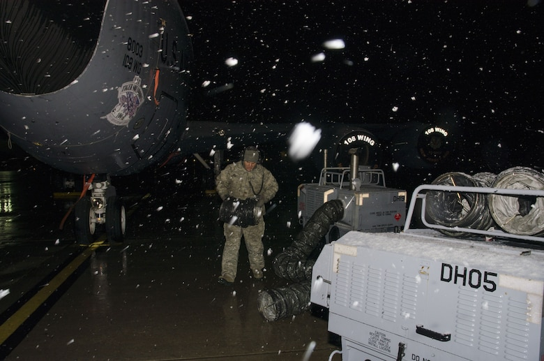 Snow falls as Master Sgt. Frank Diliberto, 108th KC-135R crew chief prepares a jet for the days flight at Joint Base McGuire-Dix-Lakehurst, N.J., Jan. 17, 2018. (U.S. Air National Guard photo by Staff Sgt. Ross A. Whitley)