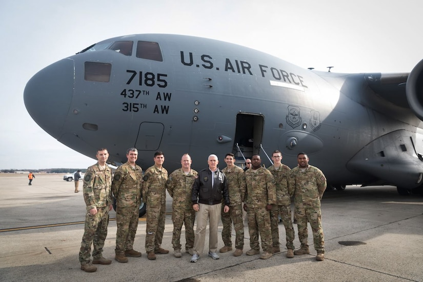 Vice President of the United States Mike Pence poses with, left to right, Air Force Lt. Col. Chris Yengo, 437th Operations Support Squadron, Maj. Jeff Dupuis, 14th Airlift Squadron, Capt. Jordan Nixon, 14th AS, Col. Louis Hansen, 437th Operations Group commander, 1st Lt. Pat Lobo, 14th AS, Tech. Sgt. Cliff Hudson, 14th AS, Airman 1st Class Tom Gauthier, 14th AS and far right, Tech. Sgt. Will Hunt, 437th Aircraft Maintenance Squadron, at Joint Base Andrews, Md., Dec. 22, 2018. The Vice President traveled to Bagram Airfield, Afghanistan, onboard an Air Mobility Command C-17 Globemaster III aircraft assigned to the 437th Airlift Wing, Joint Base Charleston, S.C., to visit U.S. service members and speak on the strategy in Afghanistan. Following a 40-minute speech, Pence thanked troops for their continued service during the holiday season.