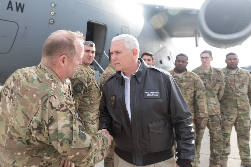 Vice President of the United States Mike Pence greets Air Force Col. Louis Hansen, 437th Operations Group commander with, left to right, Maj. Jeff Dupuis, 1st Lt. Pat Lobo, Tech. Sgt. Cliff Hudson, Airman 1st Class Tom Gauthier, all assigned to the 14th Airlift Squadron and Tech. Sgt. Will Hunt, far right, 437th Aircraft Maintenance Squadron at Joint Base Andrews, Md. Dec. 22, 2018. The Vice President traveled to Bagram Airfield, Afghanistan, onboard an Air Mobility Command C-17 Globemaster III aircraft assigned to the 437th Airlift Wing, Joint Base Charleston, S.C., to visit U.S. service members and speak on the strategy in Afghanistan. Following a 40-minute speech, Pence thanked troops for their continued service during the holiday season.