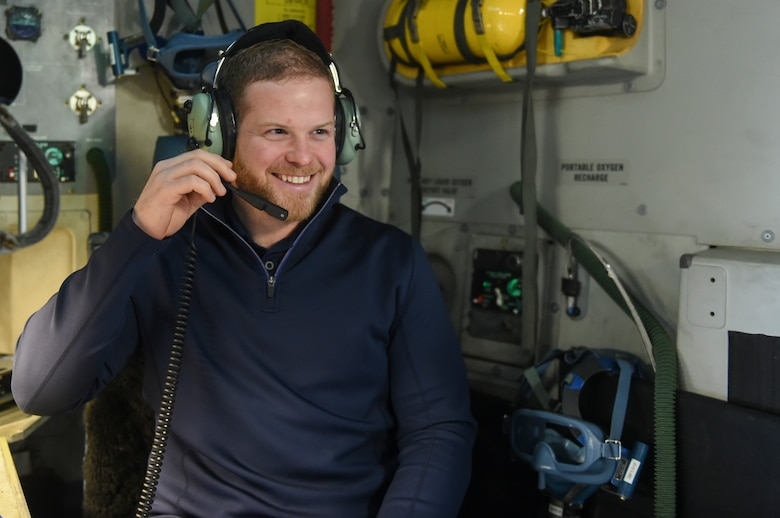 Ryan Warsofsky, South Carolina Stingrays head coach, tries on one of the headsets used by aircrew members on a C-17 Globemaster III, Jan. 10, 2018.