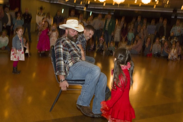 Dads, daughters saddle up to dance night away