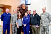 Members of the U.S. Coast Guard 13th District (Seattle) and the Western Air Defense Sector take a group photo in from of the WADS mascot, Bigfoot, after a morning of search and rescue cross-talk.  Pictured from left to right are: U.S. Coast Guard Lt. Cmdr. Courtney Harrison, U.S. Air Force Lt. Col. Brian Bergren, U.S. Coast Guard SAR expert Morgan Mak, U.S. Coast Guard Lt. Cmdr. Brook Serbu, U.S. Coast Guard Capt. Sean Cross, , U.S. Coast Guard SAR expert Scott Giard, and U.S. Air Force Lt. Col. Eric Corder.