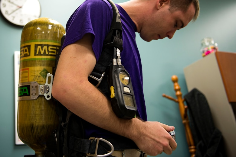 2nd Lt. Eric Olson, 23d Aerospace Medicine Squadron (AMDS) bioenvironmental engineer, secures a breathing apparatus during biohazard readiness training, Jan. 12, 2018, at Moody Air Force Base, Ga. The Bioenvironmental Engineering Flight tested their response capabilities in a simulated contamination scenario. Bioenvironmental engineering specialists focus on reducing health hazards in the workplace and surrounding areas. (U.S. Air Force photo by Airman 1st Class Erick Requadt)