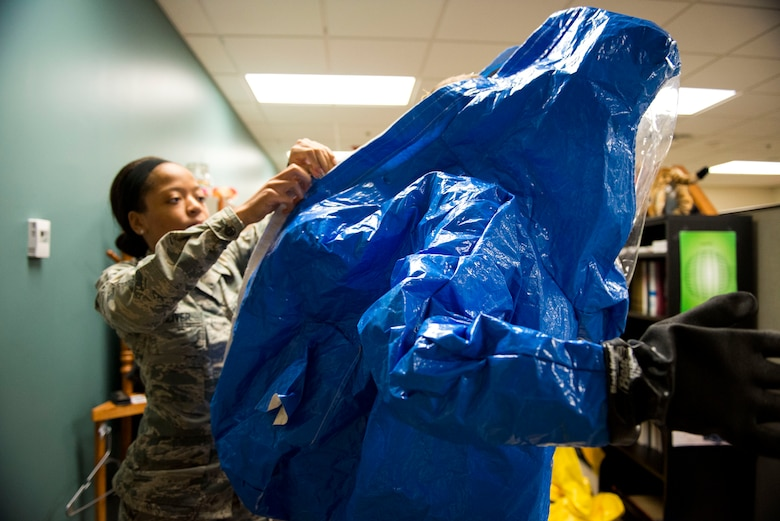 Airman 1st Class Briana McIver, left, 23d Aerospace Medicine Squadron (AMDS) bioenvironmental engineering apprentice, secures 2nd Lt. Eric Olson, 23d AMDS bioenvironmental engineer, in a Level A suit during readiness training, Jan. 12, 2018, at Moody Air Force Base, Ga. A Level A suit is designed to protect the user against any biological threat. The Bioenvironmental Engineering Flight tested their response capabilities in a simulated contamination scenario. Bioenvironmental engineering specialists focus on reducing health hazards in the workplace and surrounding areas. (U.S. Air Force photo by Airman 1st Class Erick Requadt)