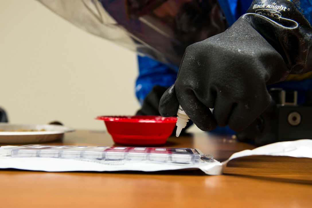 2nd Lt. Eric Olson, 23d Aerospace Medicine Squadron bioenvironmental engineer, runs unknown samples through an assay during biohazard readiness training, Jan. 12, 2018, at Moody Air Force Base, Ga. A HHA distinguishes whether or not the sample is a deadly protein. The Bioenvironmental Engineering Flight tested their response capabilities in a simulated contamination scenario. Bioenvironmental engineering specialists focus on reducing health hazards in the workplace and surrounding areas. (U.S. Air Force photo by Airman 1st Class Erick Requadt)