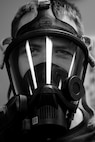 2nd Lt. Eric Olson, 23d Aerospace Medicine Squadron bioenvironmental engineer, gears up during readiness training, Jan. 12, 2018, at Moody Air Force Base, Ga. The Bioenvironmental Engineering Flight tested their response capabilities in a simulated contamination scenario. Bioenvironmental engineering specialists focus on reducing health hazards in the workplace and surrounding areas. (U.S. Air Force photo illustration by Airman 1st Class Erick Requadt)