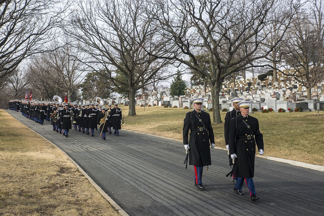 Marines with Marine Barracks Washington D.C. march in formation during a full honors funeral for Maj. Gen. Paul A. Fratarangelo at Arlington National Cemetery, Arlington, Virginia, Jan. 16, 2018.  Fratarangelo served his final active duty assignment as Commander, Marine Corps Air Bases, Western Area.