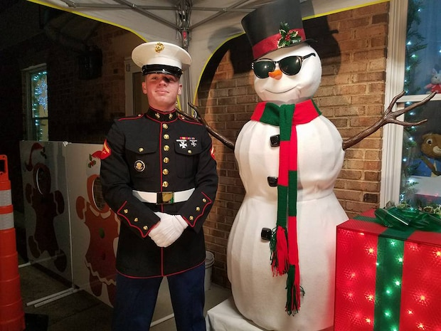 Lance Cpl. Jeffrey Lynch is shown supporting a Toys for Tots event at the Glancy Light Show.