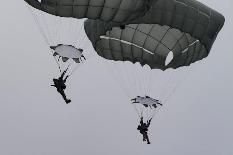 Members of the 820th Base Defense Group drift toward the ground after conducting a static-line jump from an HC-130J Combat King II, Jan. 17, 2018, at the Lee Fulp drop zone in Tifton, Ga. The 820th BDG routinely conducts static-line jumps to maintain qualifications and ensure mission readiness. (U.S. Air Force photo by Senior Airman Daniel Snider)