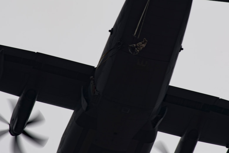 Airmen from the 820th Base Defense Group exit an HC-130J Combat King II during a static-line jump, Jan. 17, 2018, at the Lee Fulp drop zone in Tifton, Ga. The 820th BDG routinely conducts static-line jumps to maintain qualifications and ensure mission readiness. (U.S. Air Force photo by Senior Airman Daniel Snider)