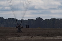 A member of the 820th Base Defense Group lands after a static-line parachute jump from an HC-130J Combat King II, Jan. 17, 2018, at the Lee Fulp drop zone in Tifton, Ga. The 820th BDG routinely conducts static-line jumps to maintain qualifications and ensure mission readiness. (U.S. Air Force photo by Senior Airman Daniel Snider)