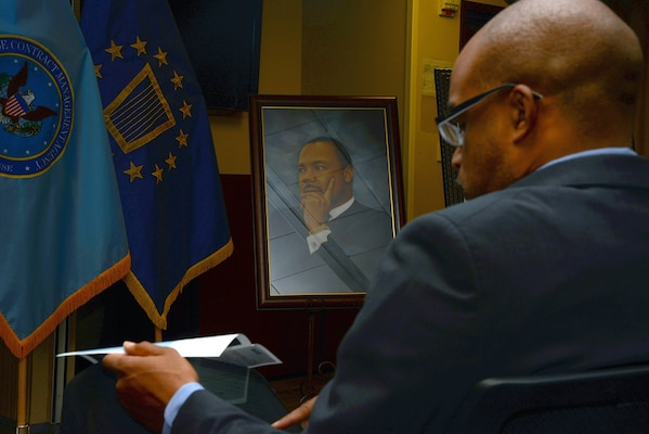 Makola Abdullah, president of Virginia State University, prepares for his speech during Defense Contract Management Agency's Martin Luther King Day celebration at its Fort Lee, Virginia, headquarters Jan. 11. Abdullah and Virginia-born poet, author and educator Latorial Faison served as the event's special guests. (DCMA photo by Thomas Perry)