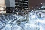 Snow warrior removes snow on sidewalk at DSCC