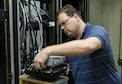 Brock Kerzmann, 47th Operations Support Squadron radar airfield weather systems electronic technician, refurbishes an electronic device used by the NexRAD WSR-88D weather radar outside Laughlin Air Force Base, Texas, Jan. 11, 2017. The radar services a wide area as part of a network of radars used to forecast weather conditions at a further distance than any other system available. (U.S. Air Force photo/Airman 1st Class Daniel Hambor)