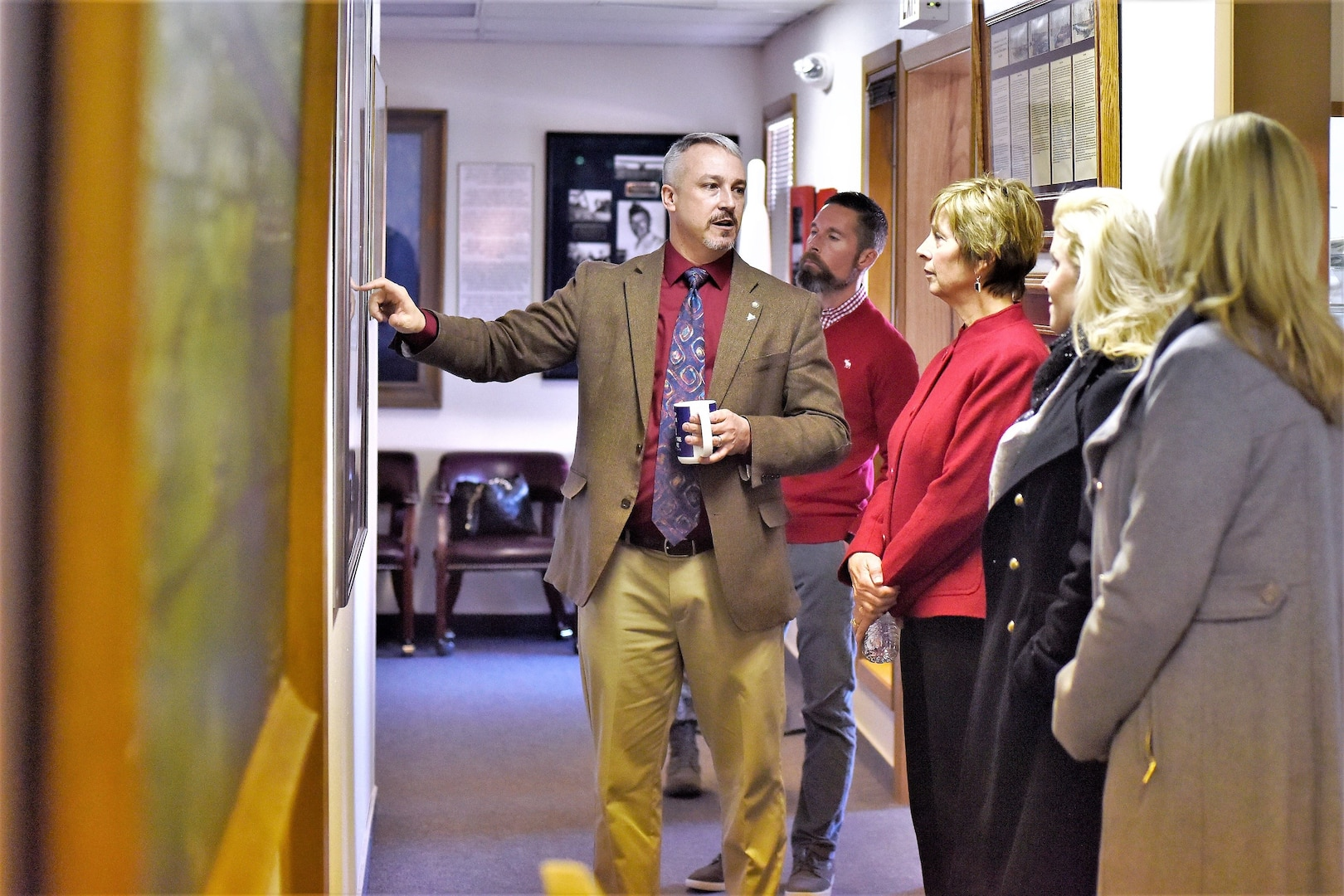 John Turnbow, director of the base museum, guides Laura Hyten (third from left) on a tour during her visit to Malmstrom Air Force Base, Montana, Jan. 17, 2018. Mrs. Hyten is married to U.S. Air Force Gen. John Hyten (not pictured), commander of U.S. Strategic Command (USSTRATCOM). While there, Gen. and Mrs. Hyten met with base leaders and airmen to thank them for their support to USSTRATCOM's deterrence mission. She also toured facilities at the base, including the resiliency center, maintenance bay and community center. (U.S. Air Force photo by Kiersten McCutchan)