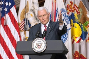 The vice president speaks from behind a podium.