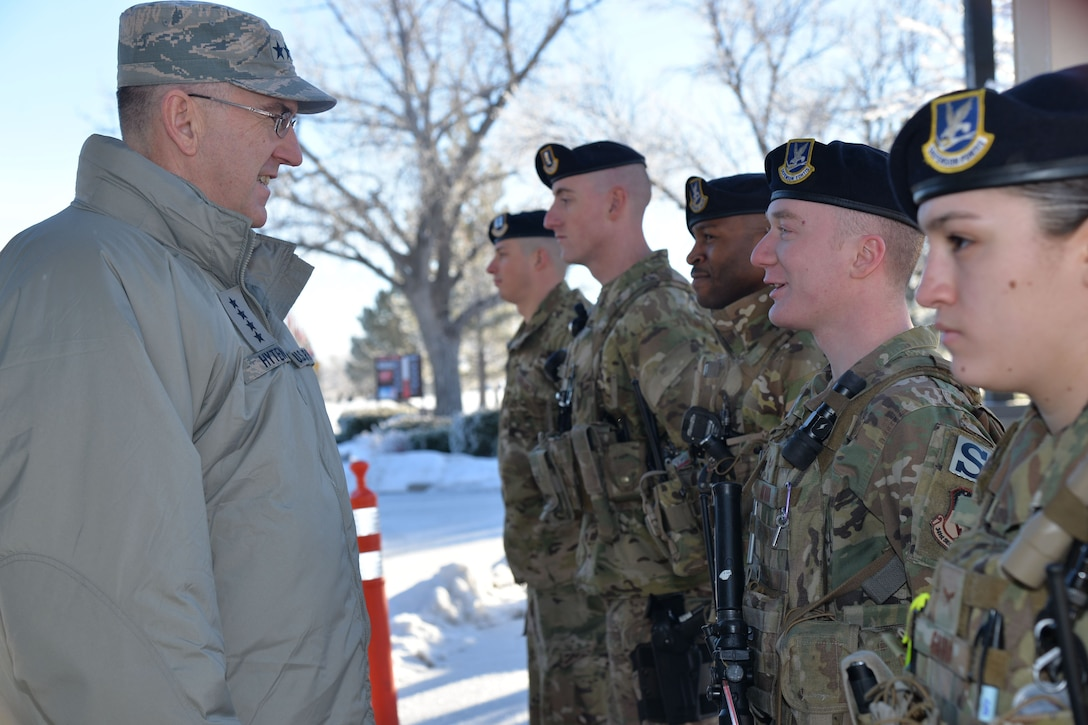 U.S. Air Force Gen. John Hyten, commander of U.S. Strategic Command (USSTRATCOM), speaks with Senior Airman Trevor Utton and other members of the 341st Security Forces Squadron at Malmstrom Air Force Base, Mont., Jan. 16, 2018.