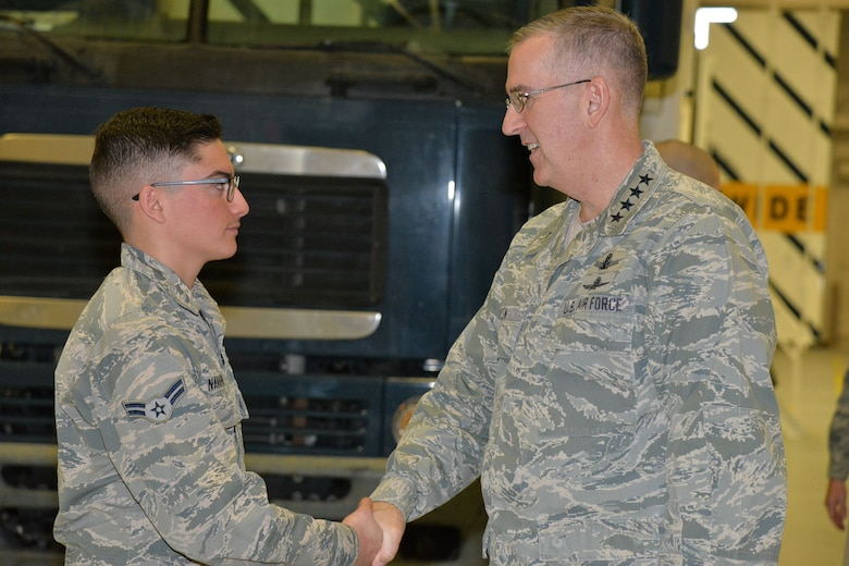 U.S. Air Force Gen. John Hyten, commander of U.S. Strategic Command (USSTRATCOM), speaks with Airman 1st Class Steven Navarro, 741st Maintenance Squadron vehicle and equipment section technician, in the maintenance bay at Malmstrom Air Force Base, Mont., Jan. 16, 2018.