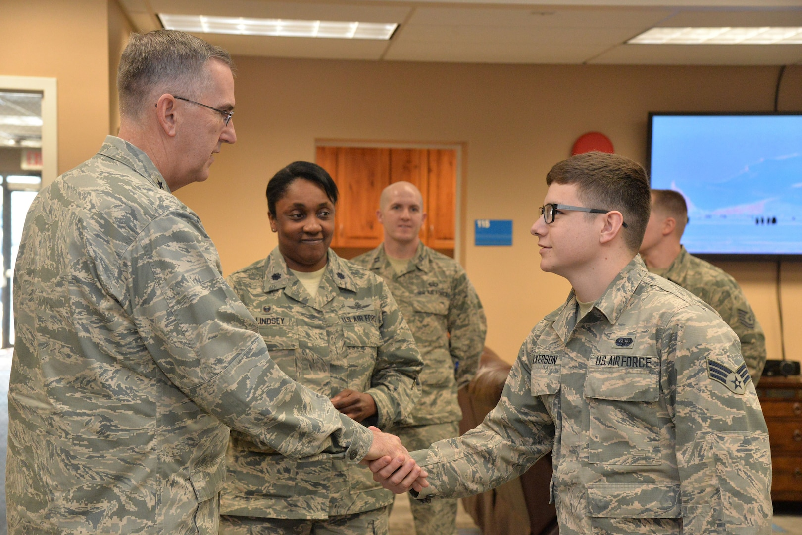 U.S. Air Force Gen. John Hyten, commander of U.S. Strategic Command (USSTRATCOM); shakes hands with Senior Airman Landon Wilkerson, 341st Communications Squadron, at the Malmstrom Air Force Base resiliency center in Montana, Jan. 16, 2018.