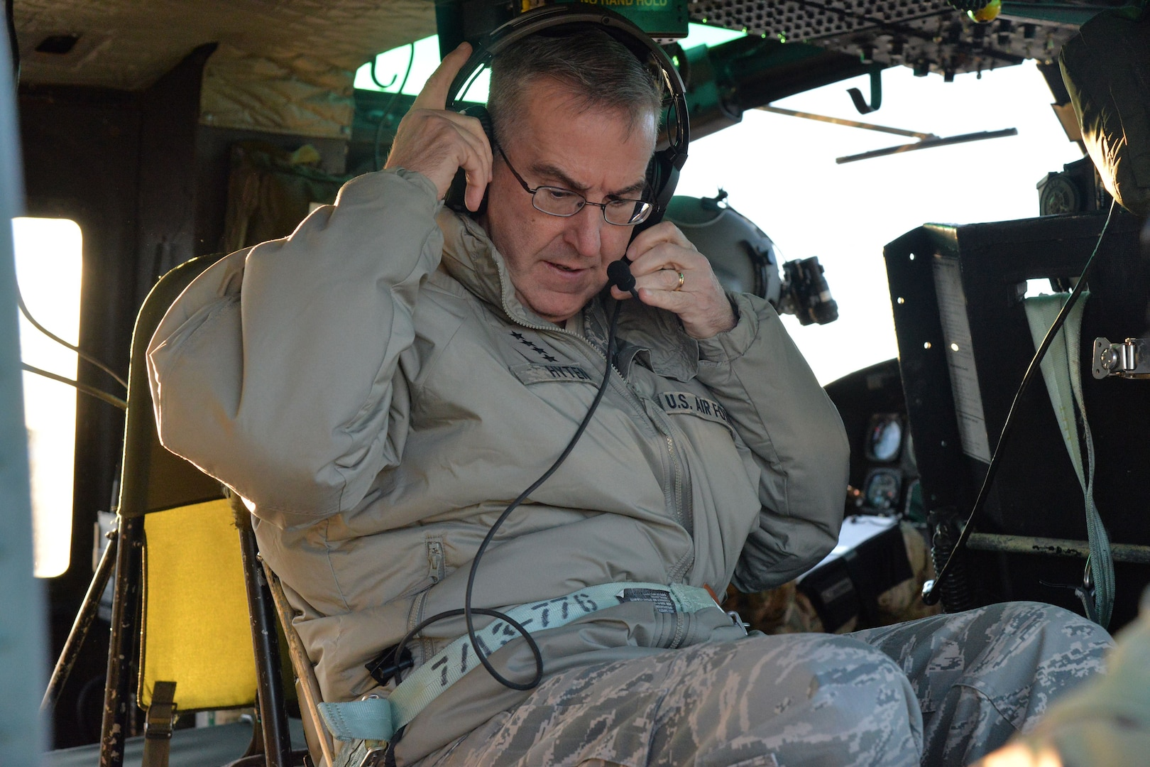 U.S. Air Force Gen. John Hyten, commander of U.S. Strategic Command (USSTRATCOM), checks his equipment before flying in a UH-1N Huey rotary aircraft at Malmstrom Air Force Base, Mont., Jan. 16, 2018.