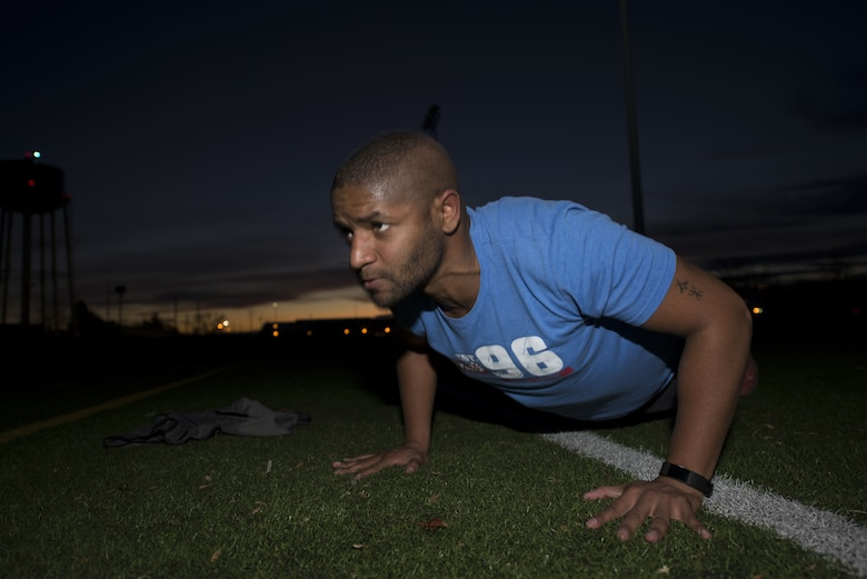 Senior Airman Joseph Amador, 366th Fighter Wing judge advocate military justice paralegal, executes a pushup during his Slimpossible exercise Jan. 12, 2018, at the Gunfighter Fitness Center, Mountain Home Air Force Base, Idaho. The Slimpossible challenge had 47 contestants participating in the challenge. (U.S. Air Force photo by Airman 1st Class Hailey Bivens)