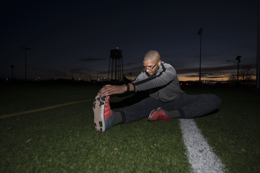 Senior Airman Joseph Amador, 366th Fighter Wing judge advocate military justice paralegal, stretches his hamstring for the Slimpossible challenge Jan. 12, 2018, at the Gunfighter Fitness Center, Mountain Home Air Force Base, Idaho. Amador performed leg stretches to cool down from his run. (U.S. Air Force photo by Airman 1st Class JaNae Capuno)