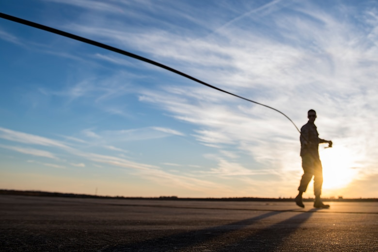 Airman 1st Class Evan Valance, 23d Logistics Readiness Squadron fuels distribution operator, drags a trigger hose away from a M-11 refueling truck to conduct HH-60G Pave Hawk hot-pit refueling operations, Jan. 16, 2018 at Moody Air Force Base, Ga. Airmen who work in the petroleum, oils and lubricants (POL) flight frequently use hot pit refueling, which is a more efficient tactic that allows aircrews a quick transition from the flight line back to their current objective. (U.S. Air Force photo by Senior Airman Daniel Snider)