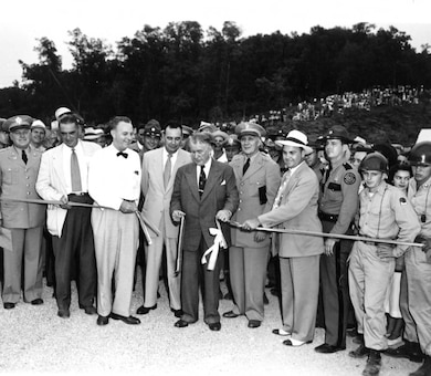 Vice President Alben W. Barkley cuts the ribbon to dedicate Wolf Creek Dam in Jamestown, Ky., Sept. 1, 1951.  Lt. Gen. Lewis A. Pick, U.S. Army Corps of Engineers commander, is standing to the right of the vice president. The U.S. Army Corps of Engineers Nashville District constructed the dam on the Cumberland River, which formed Lake Cumberland. (USACE Photo)