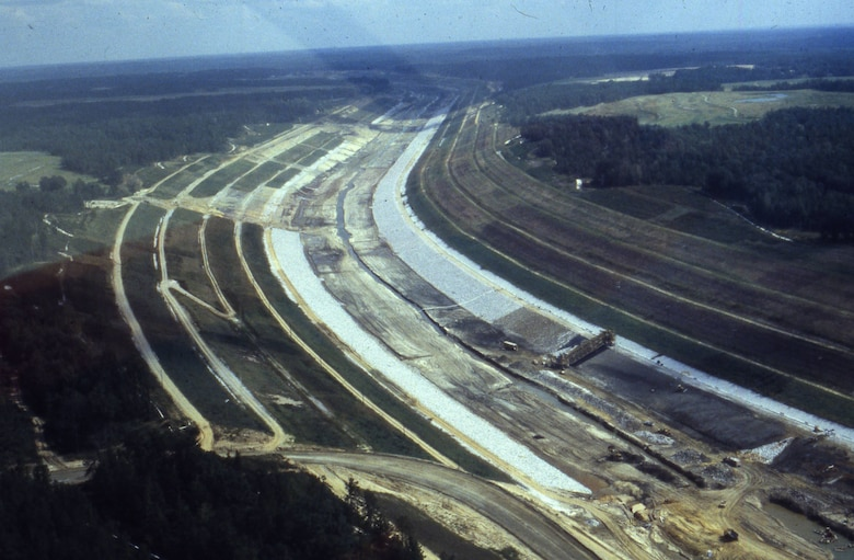 The U.S. Army Corps of Engineers Nashville District constructs the northern stretch of the Tennessee-Tombigbee Waterway in Mississippi Sept. 12, 1981.  The Mobile District and Nashville District, 125 prime contractors and 1,200 subcontractors worked on the overall waterway. The 10 locks and five dams required a total of 2.2 million cubic yards of concrete and 33,000 tons of reinforcing steel. The project, dedicated in 1985, is the largest civil works project ever constructed in the United States. (USACE Photo)