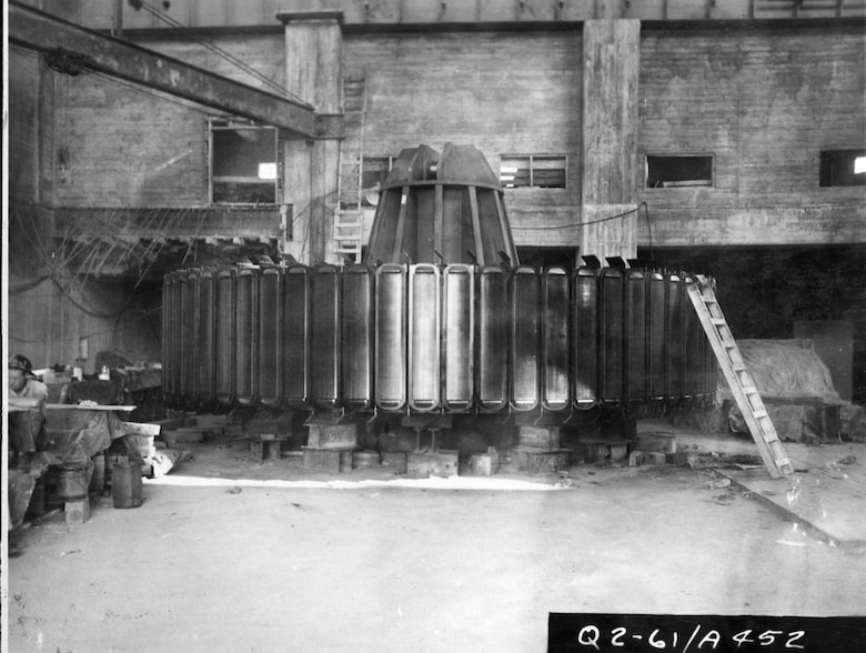 The rotor for hydropower unit six is on a pedestal July 30, 1951 at Wolf Creek Dam Power Plant in Jamestown, Ky., as the U.S. Army Corps of Engineers Nashville District constructed the hydropower house at the dam. (USACE Photo)