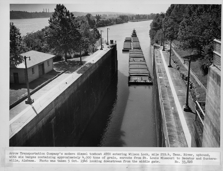 Arrow Transportation Company's diesel towboat ATCO enters Wilson Lock Oct. 5, 1946 at Tennessee River mile 259.4 in Florence, Ala.  The six bargers contained approximately 4,000 tons of grain from St. Louis, Mo., headed to Decatur and Guntersville, Ala. The U.S. Army Corps of Engineers Nashville District operate and maintain the lock at the Tennessee Valley Authority project. (USACE Photo)