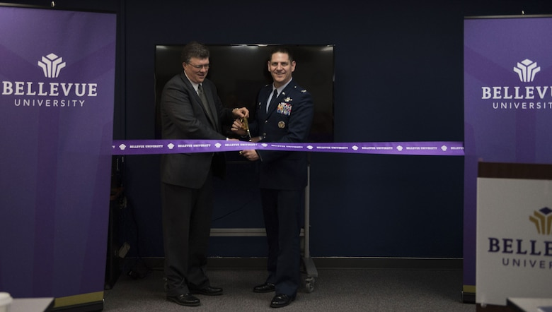 Jim Grotrian, Bellevue University vice president of strategic partnerships, and Col. Joe Kunkel, 366th Fighter Wing commander, participate in a ribbon cutting ceremony for the opening of Bellevue University at the education center Jan. 18, 2018, at Mountain Home Air Force Base, Idaho. Bellevue University is the forth college to offer services at the education center here. (U.S. Air Force photo by Airman 1st Class Alaysia Berry)