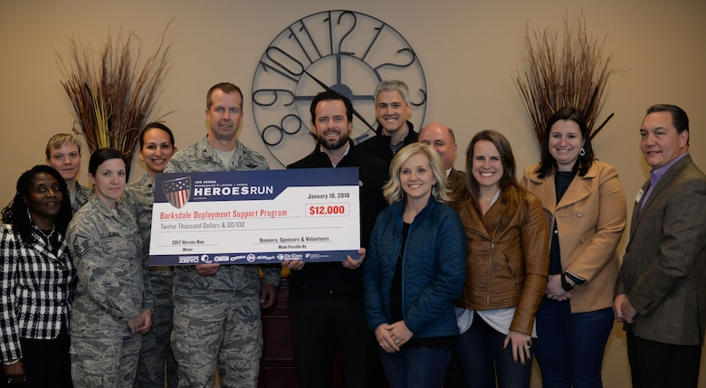 Members of the 2nd Bomb Wing and Brookshire's Grocery Company pose for a photo with a $12,000 check at Barksdale Air Force Base, La., Jan. 18, 2018.