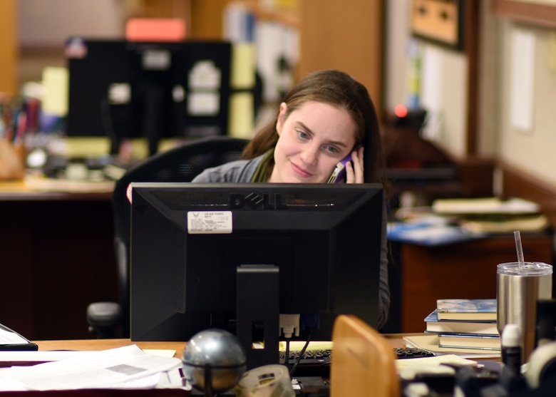 Emily Copeland, the 325th Force Support Squadron's new librarian, works at her desk in the base library at Tyndall Air Force Base, Fla., Jan. 18, 2018. Copeland graduated from Hanover College with a bachelor's degree in medieval and renaissance studies. She then went on to earn both her Master of Science and doctorate in medieval studies from the University of Edinburgh, Scotland. (U.S. Air Force photo by Airman 1st Class Isaiah J. Soliz/Released)