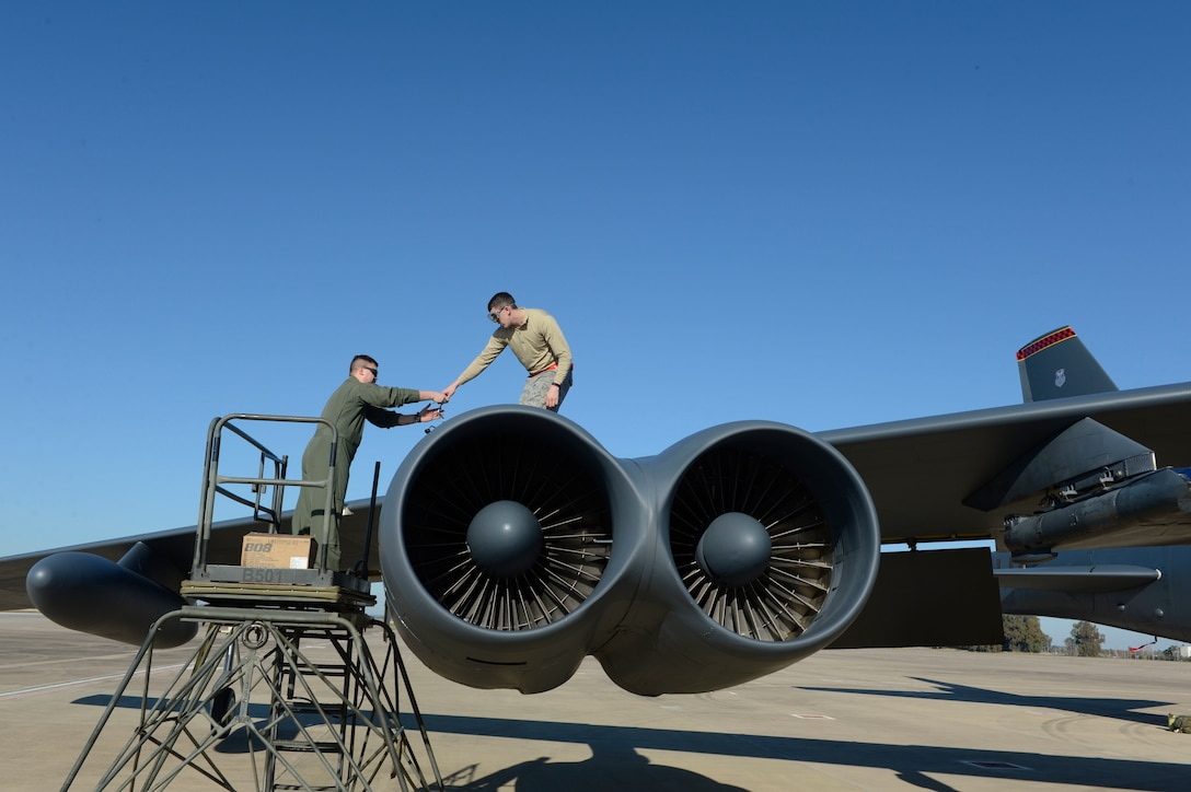A crew member and maintainer, assigned to the 23rd Expeditionary Bomb Squadron, perform flight inspections on a B-52 Stratofortress, at Morón Air Base, Spain, Jan. 16, 2018. The deployment of four B-52s to Europe helps exercise United States Air Forces in Europe's forward operating location for bombers. (U.S. Air Force photo by Senior Airman Natalie Plas)