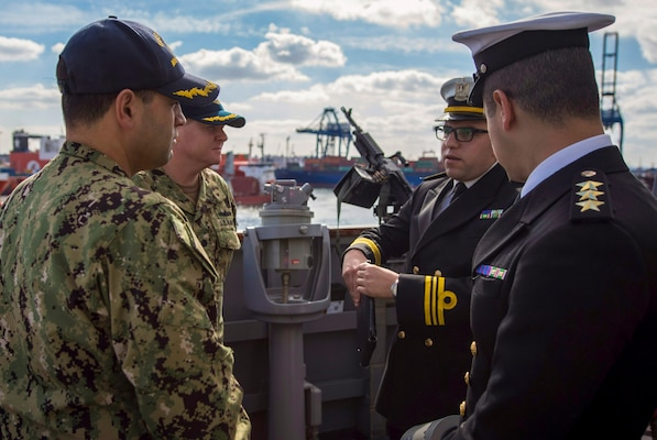 180116-N-KA046-0378 ALEXANDRIA, Egypt (Jan. 16, 2017) Cmdr. Tyson Young, executive officer, left, and Cmdr. Peter Halvorsen, commanding officer of the Arleigh Burke-class guided-missile destroyer USS Carney (DDG 64) speak with Egyptian naval officers on the bridge wing. Carney, forward-deployed to Rota, is on its fourth patrol in the U.S. 5th Fleet area of operations in support of maritime security operations to reassure allies and partners and preserve the freedom of navigation and free flow of commerce in the region. (U.S. Navy photo by Mass Communication Specialist 2nd Class James R. Turner/Released)