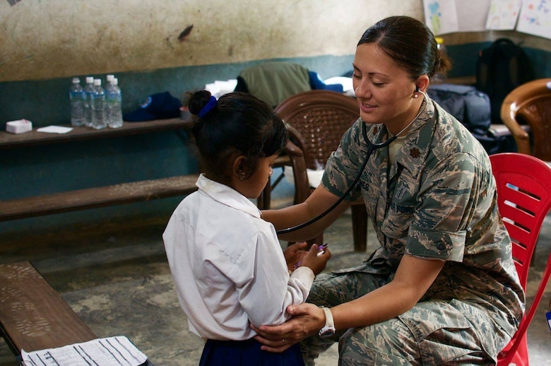 Maj. Linda Jones, U.S. Air Force Pediatric Medical Director with the 628th Medical Operations Squadron works with a patient in Nepal in July 2017. Jones is just one of the International Health Specialists (IHSs) supporting U.S. Pacific Command's (PACAF) capacity-building efforts by providing medical, dental, optometry, and engineering assistance to their citizens. (U.S. Air Force photo)
