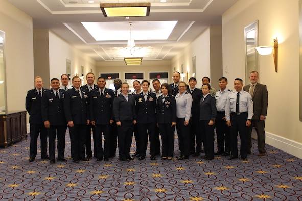 A group of U.S. Air Force Medical International Health Specialists (IHSs) pose for a group photo at the 2017 Association of Military Surgeons of the United States (AMSUS) conference, Nov 30, 2017. IHSs are made up of health care professionals who bring their diverse intercultural, medical, and military operations experiences together to build partnership capabilities in allied countries. (U.S. Air Force photo by Karina Luis)