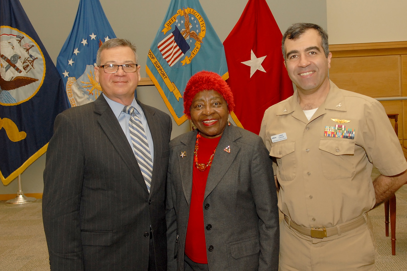 Retired Army Brig. Gen. Clara Adams-Ender (center), is joined by DLA Troop Support Deputy Commander Richard Ellis (left) and NAVSUP Weapons Systems Support Director of Engineering and Product Support Navy Capt. Armen Kurdian (right) following a presentation in honor of Civil Rights leader Dr. Martin Luther King, Jr. Jan. 16 in Philadelphia.
