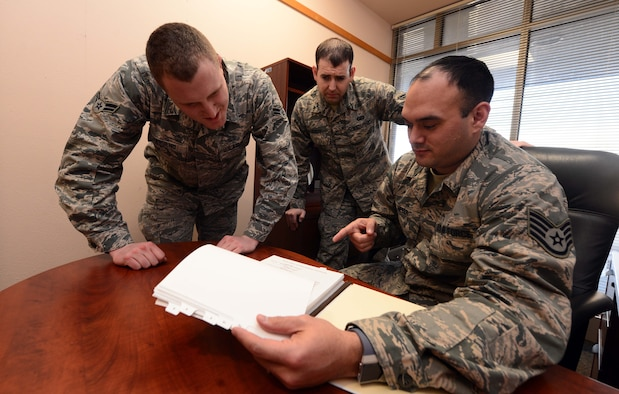 (From left to right) Airmen 1st Class Justin Townsend and Daniel Stilts, contract specialists assigned to the 28th CONS train with Staff Sgt. Tanner Meyer, a contracting officer assigned to the 28th Contracting Squadron, on the contract process at Ellsworth Air Force Base, S.D., Jan. 11, 2018. The 28th CONS is one of the smallest squadron on base, but plays an important role in providing agile contracting support and business advice to those who work at Ellsworth AFB. (U.S. Air Force photo by Airman 1st Class Donald C. Knechtel)